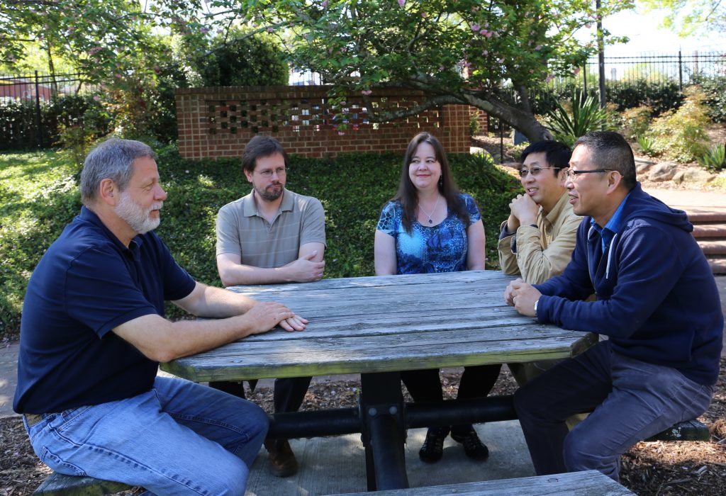 Identity Management staff outside at a picnic table