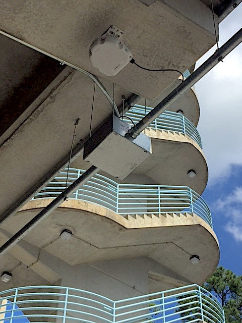 Pervasive wireless equipment on the ceiling of a Kenan Stadium Concourse