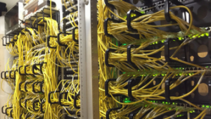 Yellow VoIP cables in Old Clinic wiring closet