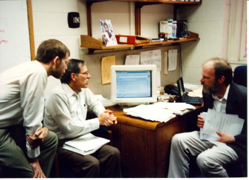 In October 1996, Ben Aycock (OIS), Steve Squires and Tim Cline (HSL) discuss the new UNCLE web interface