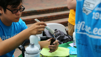 ResNET staffer cleans phone at event