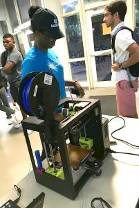 A ResNET staff member operates equipment at a ResNET tech fair