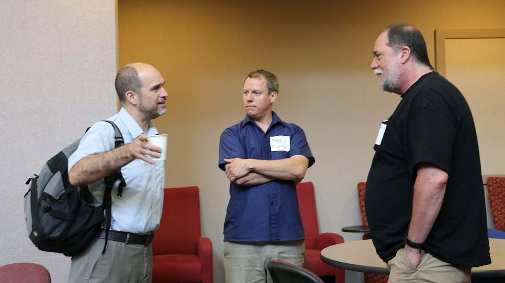 BarCamp participants, including CTC Advisory Board President Bil Hays, far right, talk before joining a break-out session