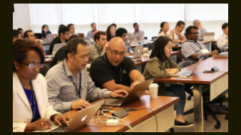 Participants learn in the lab portion of the Deep Learning Symposium
