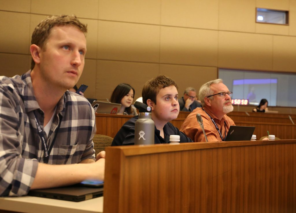 Karl Eklund, Tucker McGuire and Tim McGuire listen to a presentation at the Deep Learning event
