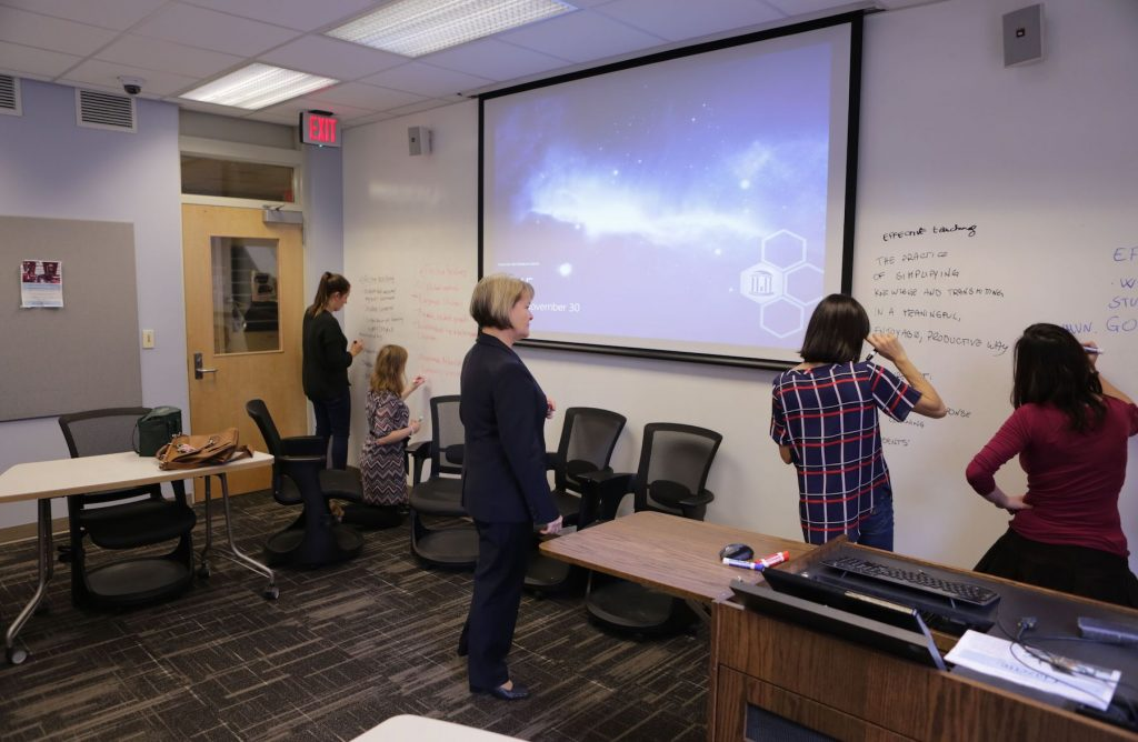 Glynis Cowell, Teaching Professor in Romance Studies, works with students using whiteboard walls in flexible classroom Dey 205.
