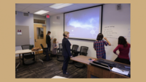 Glynis Cowell, Teaching Professor in Romance Studies, works with students using whiteboard walls in flexible classroom Dey 205. Photo: Lars Sahl
