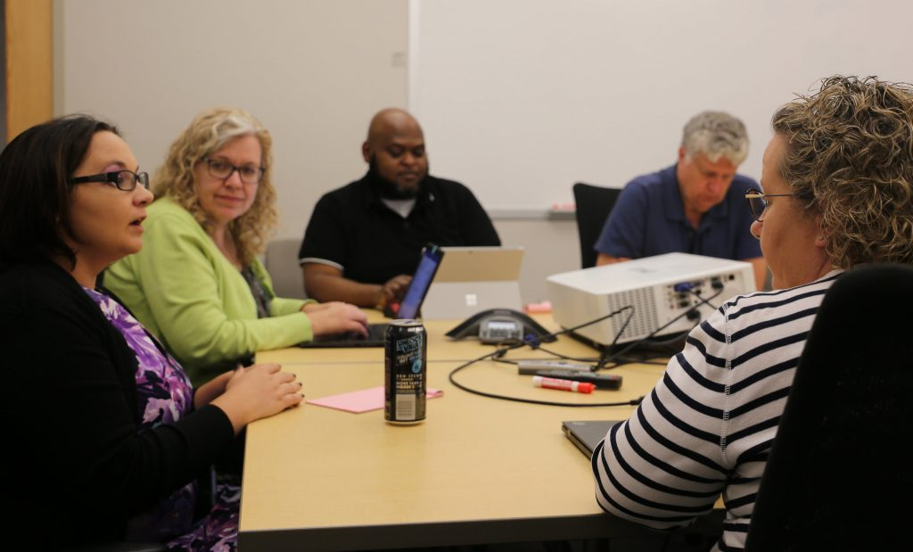Kat Moore provides guidance to Enterprise Applications staff members