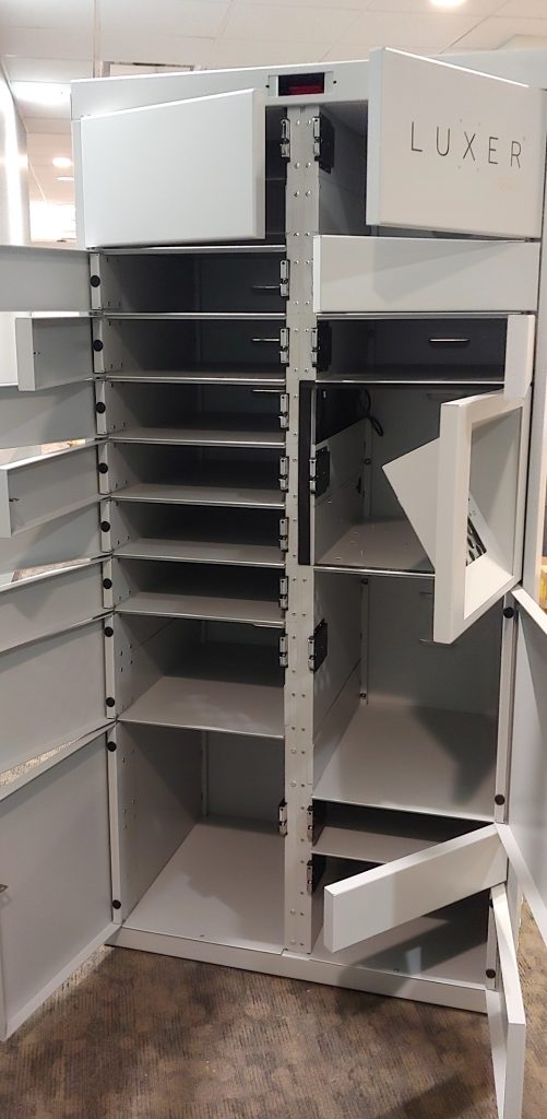 Luxer Lockers unit with its 15 compartments open