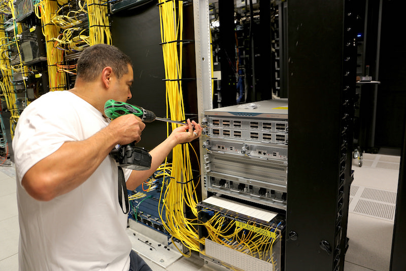 Mike Whitfield installs equipment in the ITS Franklin data center