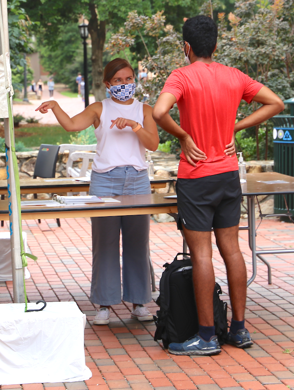 Assistant Vice Chancellor Kate Hash talks with a student